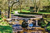 stock photo of slab  - The Clapper bridge in the picturesque village of Wycoller - JPG