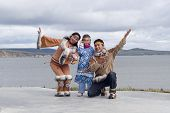 image of chukotka  - Chukchi family in folk dress in dance position - JPG