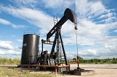 pic of oil well  - pumpjack pumping crude oil from oil well - JPG