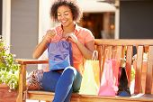 image of mall  - Woman Resting With Shopping Bags Sitting In Mall - JPG