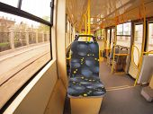 foto of tram  - Empty tram rides through the streets of the city  - JPG