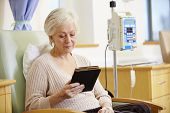 foto of chemotherapy  - Senior Woman Undergoing Chemotherapy With Digital Tablet - JPG