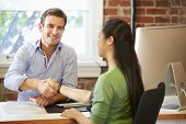 picture of interview  - Businessman Interviewing Female Job Applicant In Office - JPG
