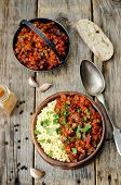 pic of millet  - buttered millet with tomato eggplant curry on wooden background - JPG