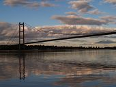 image of fascinating  - Approaching the bridge from the East on a yacht the blue sky and magnificent bridge coupled with the reflections in the water make this a fascinating shot - JPG