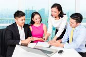 pic of counseling  - Asian banker team counseling client finance investment in bank office  - JPG