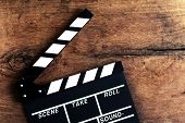 picture of clapper board  - Movie clapper board on old wooden background - JPG