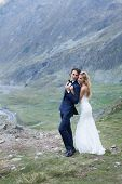 stock photo of she-male  - Married couple admiring the beautiful view of mountains - JPG
