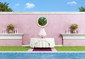 foto of three tier  - Wedding cake on the round table in an elegant garden near a swimming pool  - JPG