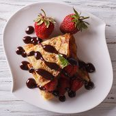 foto of crepes  - crepes with strawberries and chocolate close - JPG
