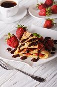 picture of crepes  - crepes with strawberries and coffee on a table close - JPG