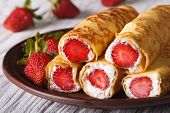 stock photo of crepes  - Crepes with fresh strawberries and cream cheese on a plate close - JPG