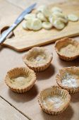 picture of whip-hand  - Cooking of little homemade oat tarts with whipped cream - JPG