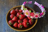 pic of headband  - Summer headband for hair and fresh strawberry in a plate on a wooden background - JPG