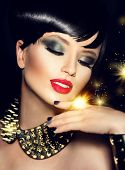 stock photo of hair cutting  - Beauty Fashion Model Girl with bright Makeup and golden Accessories - JPG