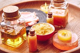 image of scrubs  - Spa still life with sea salt oil and scrub for body on wooden background - JPG