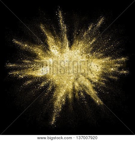 poster of Gold powder particles explosion. Glitter burst with golden texture. Golden color dust splash for fas