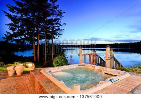 poster of Awesome Water View With Hot Tub At Dusk In Summer Evening.