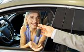 auto business, car sale, consumerism and people concept - happy woman taking car key from dealer in  poster