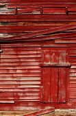foto of red barn  - Image of a red rutic barn exterior can be used as a great background - JPG