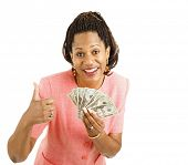 Beautiful African-american businesswoman holding a hand full of cash and giving a thumbsup sign.  Is