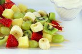 stock photo of fruit platter  - Fresh fruit Kebab made of strawberries Grapes kiwis bananas and pineapples - JPG