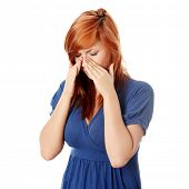 foto of sinus  - Young woman with sinus pressure pain  - JPG
