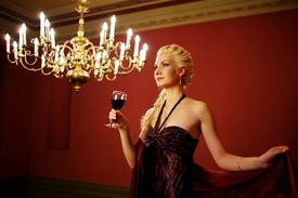 image of red wine  - Attractive lady with a glass of red wine - JPG