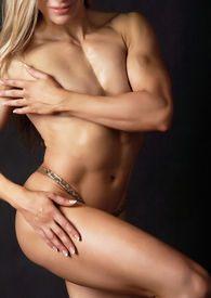 pic of athletic woman  - A woman bodybuilder showing her muscular body - JPG