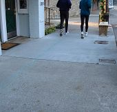 Runners On Sidewalk