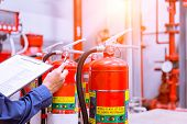 Engineer Checking Industrial Fire Control System,fire Alarm Controller, Fire Notifier, Anti Fire.sys poster