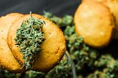 Macro Cookies With Cannabis And Buds Of Marijuana On The Table. A Can Of Cannabis Buds Concept Of Co poster