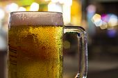 Cold Beer Cup Closeup With Nightlife Lights On Background. Draft Beer In Glass Banner Template. Beer poster