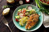 Grilled Salmon Steak And Vegetarian Vegetable Salad Of Radish, Cucumbers, Lettuce Salad. Healthy Pro poster