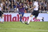 VALENCIA - OCTOBER 17 : Leo Messi (C) of Barcelona FC in action at Spanish soccer league match Valen
