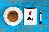 May 8th. Day 8 Of May Month, Calendar Written On Morning Coffee Cup At Blue Wooden Table, Top View.  poster