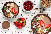 Chocolate Banana Protein Smoothie Bowls With Granola, Strawberry And Pomegranate Seeds Decorated Wit poster