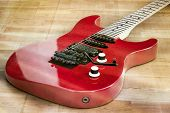 foto of stratocaster  - A full body shot of red old guitar placed on the floor - JPG