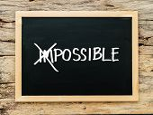 Text Impossible On Black Chalk Board With Cross Over On im. Possible ,success And Challenge Concep poster
