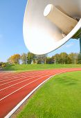 Outdoor Racetrack For Runners, With Close-Up Of The Speaker poster