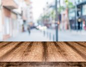 Wooden empty table board in front of blurred background. Can be used for display or montage any prod poster