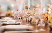 Served Dinner Table In A Restaurant. Restaurant Interior. Cozy Restaurant Table Setting. Defocused B poster