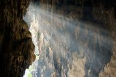 Rays Of Sunlight Fall On The Wall Of Cave. Concept Of Hope, Discovery. poster