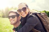 travel, hiking, backpacking, tourism and people concept - happy couple in sunglasses with backpacks  poster