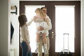 Happy Father Hugging Little Daughter Arriving Returning After Long Trip, Smiling Dad Holding Kid Gir poster