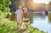 Happy Senior Couple Near Water. Old People Smiling, Summer Nature. poster