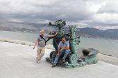 Men Posing With Sculpture