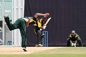 PUCHONG, MALAYSIA - SEPT 24: Malaysia's Madhavan bats a Guernsey's Adam Martel's bowl at the Pepsi ICC World Cricket League Div 6 finals at the Kinrara Oval on September 24, 2011 in Puchong, Malaysia.