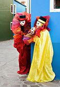 Two Clowns In Mask Performing