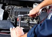 stock photo of internal combustion  - Hands of mechanic working in auto repair shop - JPG